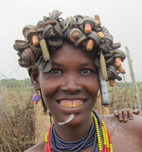 Desenech woman with bottle cap head adornment